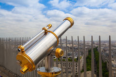 View from Arc de Triomphe and tourist telescope in Paris, Stock Photo