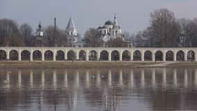 View of the arcade and temples of Veliky Novgorod, April day. Russia. View of the arcade and temples of Veliky Novgorod, cloudy April day. Russia stock video