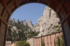 View through the arch of the Basilica. The buildings of the monastery of Montserrat. View through the arch of the Basilica Stock Image