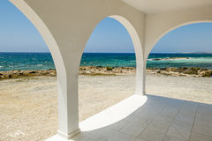 The view through the arch on a beautiful seascape. The view through the arch on a beautiful Sunny seascape Royalty Free Stock Images