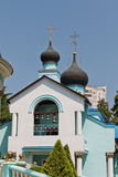 View of the arch and the bell tower at Holy Trinity Church in So. SOCHI, RUSSIA - AUGUST 13: View of the arch and the bell tower at Holy Trinity Church in Sochi Royalty Free Stock Image