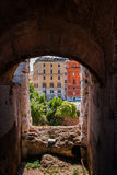 View through an arch of the Colosseum on the street Royalty Free Stock Image