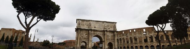 Arch of Constantine and Coliseum. View of the arch of Constantine near the Coliseum in Rome, Italy Royalty Free Stock Photo
