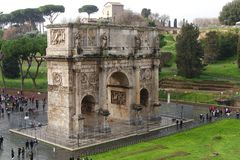 View of the Arch of Constantine in rainy day in Rome, Italy. Rome, Italy - February 2, 2018: View of the Arch of Constantine in rainy day from Colosseum in Rome Royalty Free Stock Images
