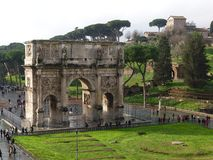 View of the Arch of Constantine in rainy weather in Rome, Italy. Rome, Italy - February 2, 2018: View of the Arch of Constantine in rainy weather from Colosseum stock photos