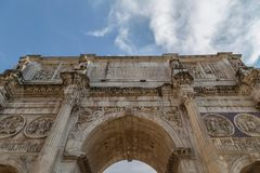 View of the arch of Constantine in Rome, Italy. View of the arch of Constantine, near the Coliseum in Rome, Italy. Sky with clouds in background Stock Images