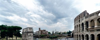 View of the Arch of Constantine, the temple of Venus and Rome an. D a side of the Roman Coliseum in Rome Italy with a cloudy sky Stock Photography
