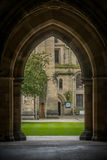 View Through Arch Glasgow University. Stone Arch Glasgow University Campus Royalty Free Stock Photo