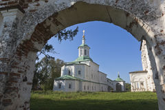 View through the arch of the Holy Gate to the Church of St. Sergius of Radonezh in Dymkovo Sloboda of Veliky Ustyug. Vologda Region, Russia Royalty Free Stock Photography
