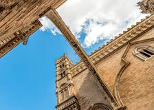 View of arch and tower of Palermo Cathedral with perspective from below, Sicily, Italy Stock Photos