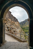 View through the arch on Vardzia cave monastery. Georgia. View through the arch on Vardzia cave monastery, complex of carved in rock . Georgia Royalty Free Stock Photo