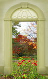 View through arched door, autumnal park Stock Image