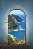 View through arched door, coastal landscape Royalty Free Stock Photography