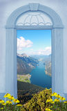 View through arched door, lake view in the alps Royalty Free Stock Image