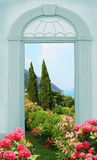 View through arched door, mediterranean landscape Royalty Free Stock Images
