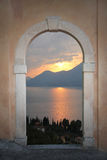 View through arched door; mediterranean sunset Royalty Free Stock Photography