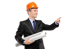 A view of an architect with blueprints pointing Stock Image