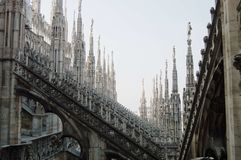 View of architectural detail of Duomo di Milano roofs. Foogy morning. Gloomy gothic. View of architectural detail of Duomo di Milano roofs Royalty Free Stock Photography
