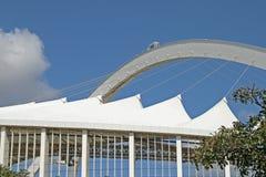 ARCH OVER MOSES MABHIDA STADIUM. View of architectural detail of Moses Mabhida stadium in Durban Kwazulu Natal against blue sky Stock Photos