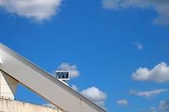 SKY CAR ON ARCH OF MOSES MABHIDA STADIUM. View of architectural detail of Moses Mabhida stadium in Durban Kwazulu Natal against blue sky Royalty Free Stock Photo