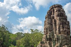An architecture of Bayon face at Bayon Castle in Siem Reap, Camb. View of an architecture of Bayon face at Bayon Castle in Siem Reap, Cambodia stock photography