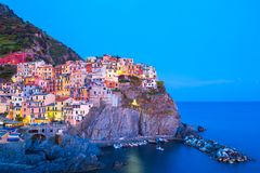 View on architecture of Manarola town in sunset light. Manarola is one of the most popular town in Cinque Terre National stock photo