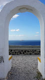 View through archway to aegean sea of santorini island Stock Photo