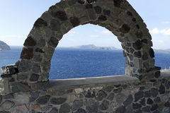 View through archway to aegean sea of santorini island Stock Photography