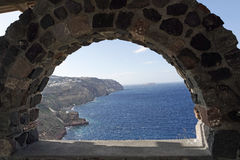 View through archway to aegean sea of santorini island Stock Photos
