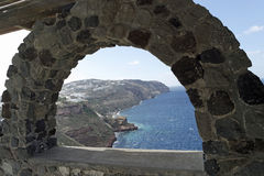 View through archway to aegean sea of santorini island Royalty Free Stock Photo