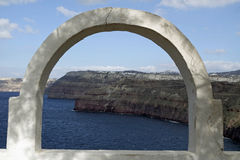 View through archway to aegean sea of santorini island stock images