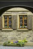 View through archway to idyllic house facade of sandstone Royalty Free Stock Image