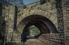 View of the arcs of the old historic stone bridge Stock Images
