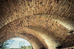 View of the arcs of the old historic stone bridge Stock Photos