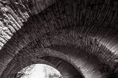 View of the arcs of the old historic stone bridge Stock Photography
