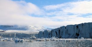 View of an Arctic glacier. A view of a glacier on The Arctic Ocean stock photos