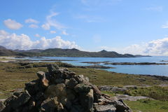 View of Ardnamurchan Point. This picture shows Ardnamurchan Lighthouse, Ardnamurchan Point, on the West Coast of Scotland. In the foreground is a stone cairn Stock Photos