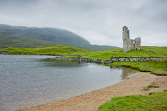 View of Ardvreck Castle in Scotland in cloudy day Stock Photos
