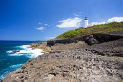 Arecibo lighthouse from Puerto Rico coast with rocky shore and ocean stock images