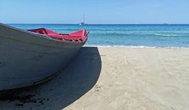 Is Arenas beach with a old boat in southern Sardinia royalty free stock images