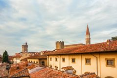 Arezzo historic center skyline. View of Arezzo historic center skyline with old towers, cathedral gothic belfry and characteristic red roof tiles stock photo