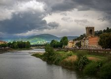 View of the Arno River. Bad weather in Florence. Tuscany. Italy. The beauty of Italian Tuscany in the spring royalty free stock image