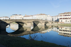 View of Arno river bank with architecture  buildings and bridge reflecttions Stock Photo