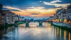 View of the Arno river, Florence and the St Trinity Bridge. Florence, Italy. View of the Arno river, evening Florence and the St Trinity Bridge. Florence, Italy royalty free stock images