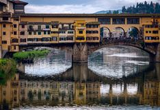 View from the Arno River to the Ponte Vecchio bridge. The old city of Florence. Italy. The old city of Florence. Italian beauty royalty free stock photos