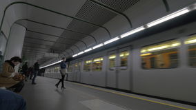 View of arrivals of train on the subway station and people coming in, Vienna, Austria. VIENNA, AUSTRIA - APRIL 26, 2016: View of arrivals of train on the subway stock footage