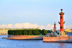 View of Arrow of Vasilevsky island and Rostral columns in summer. At sunset  in Saint-Petersburg. St. Petersburg Royalty Free Stock Photo