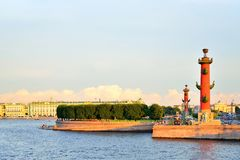 View of Arrow of Vasilevsky island and Rostral columns under blu. E sky at sunset in Saint-Petersburg. St. Petersburg Royalty Free Stock Photo