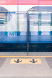 View of  arrows sign on platform at Sky train station. - Split to Stock Images