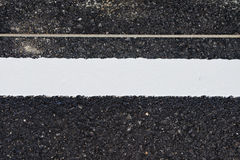 View of asphalt with distinct white stripes. Stock Photo
